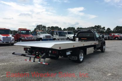 2017 Ford F550 with a Jerr Dan Car Carrier Tow Truck.