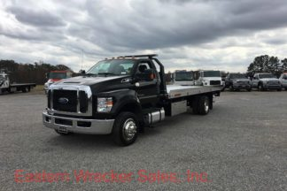 Ford F650 Tow Truck with a Jerr Dan Aluminum Car Carrier Rollback.